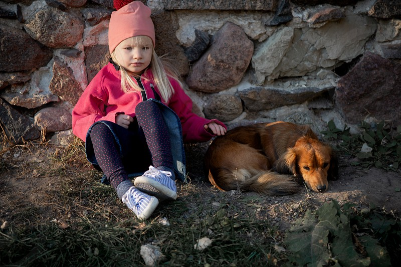 Little girl and dog photo