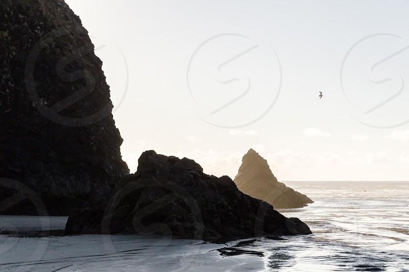 large rocks on the beach photo