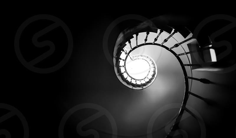 Ancient spiral staircase seen from below. Black and white shot photo