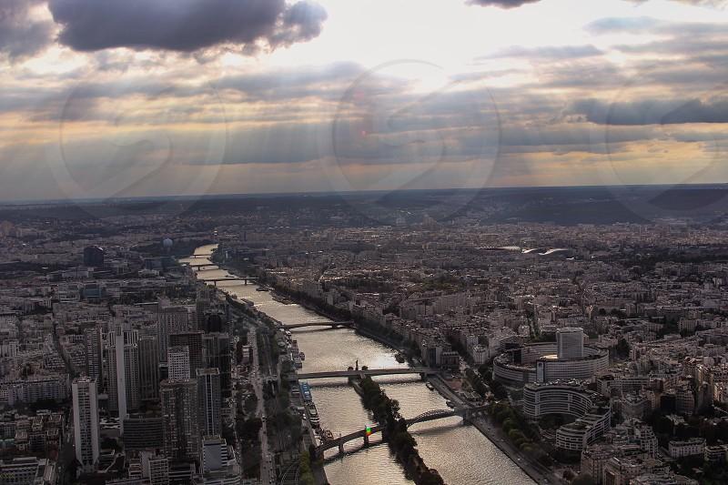 River bridge birdseye  Seine paris france sunset buildings rays photo
