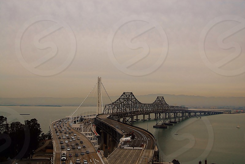 cars on white and brown concrete bridge photo