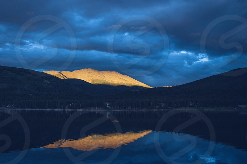 mountains lake reflection sunset scenic beautiful inspirational blue moody nature sky cloudy clouds reflected photo