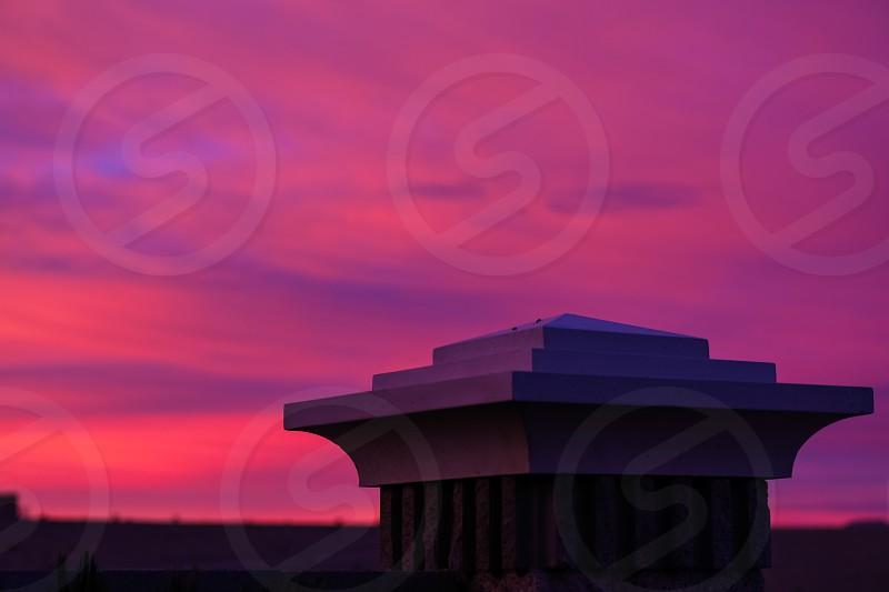 skysunsettwilightsunriseduskdawnpinkpurplewallcolumnfencedecorarchitectureromanticcloudsopenopen skygardenyardcolorful photo