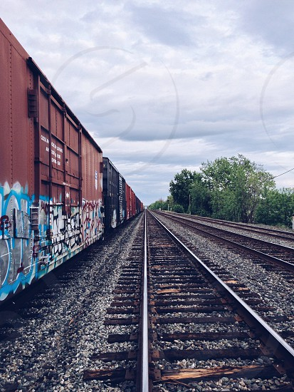 maroon container train with graffiti photo