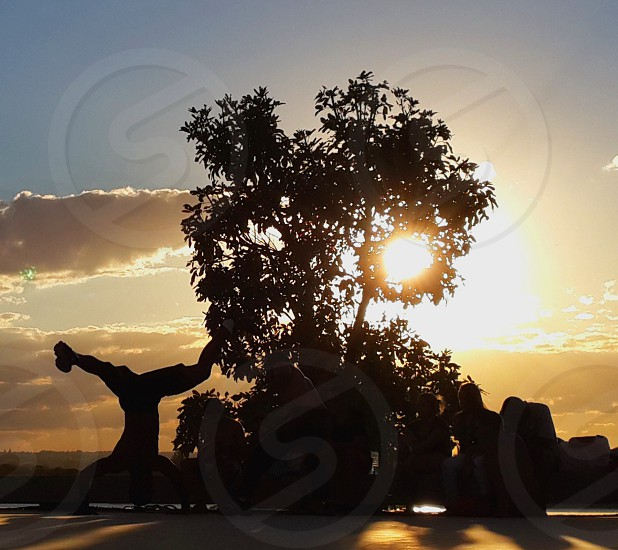 dancing capoeira in brasil at sunset photo