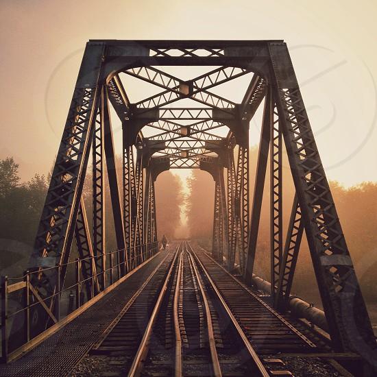 Warm morning light on train bridge photo