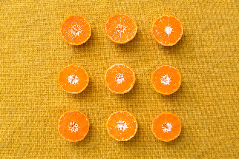 clementines on a mustard yellow background photo