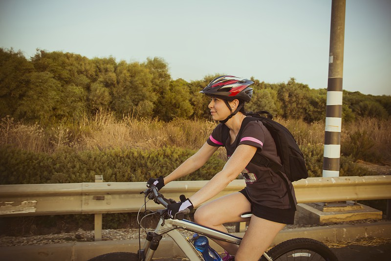 Woman riding a bicycle in the countryside. photo