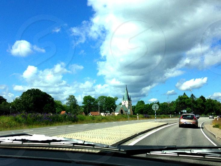 brown hatchback car on gray asphalt road photo