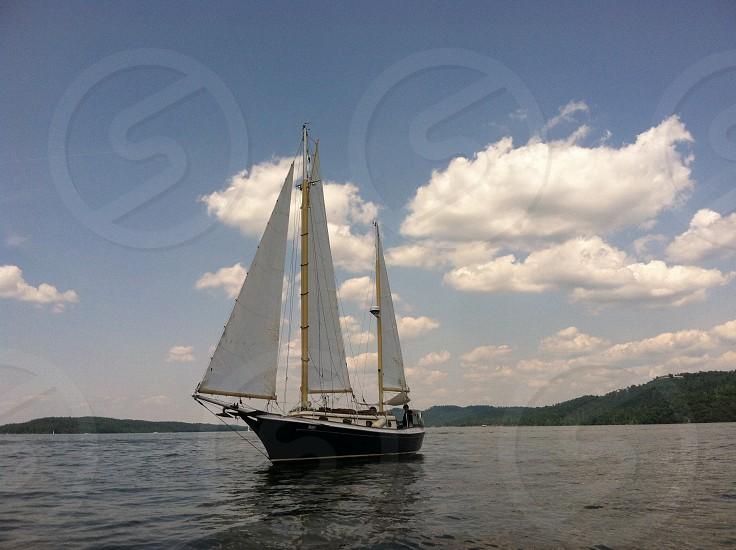 white and black sailboat photo