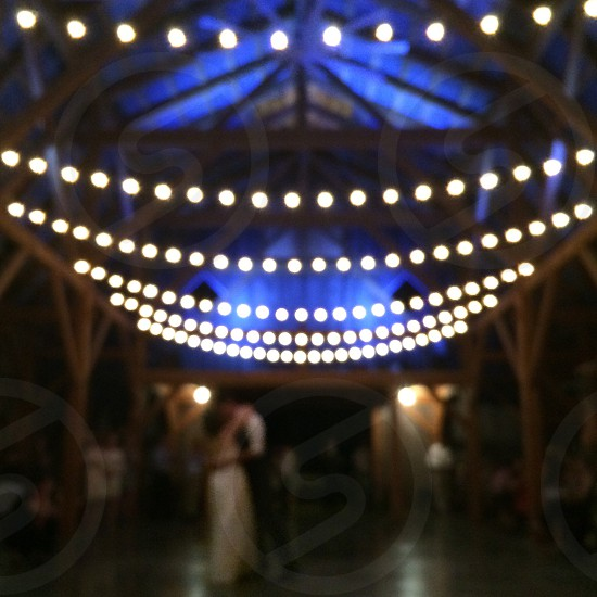 man and woman dancing under brown gazebo photo