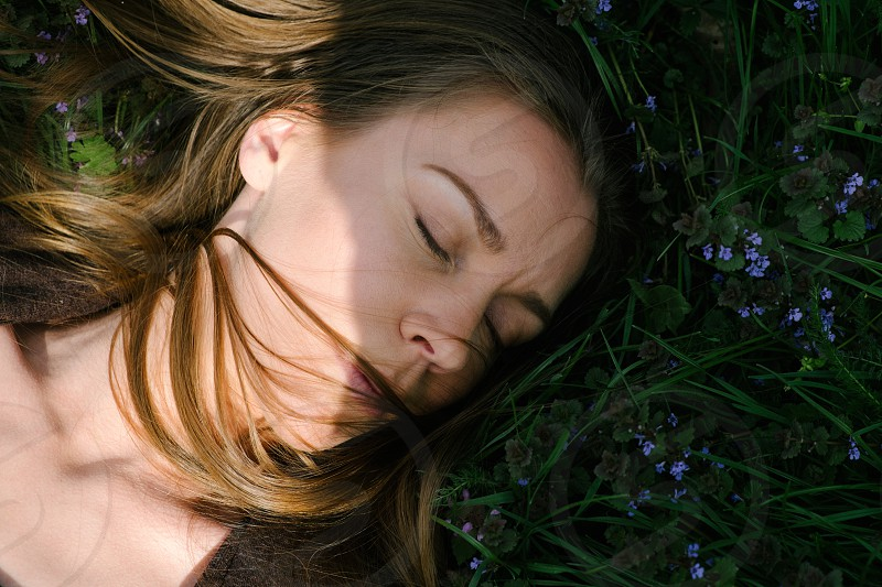 Relaxing woman on grass photo