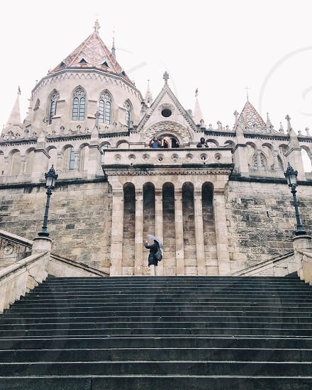 Tourists exploring castle in Budapest photo