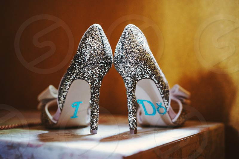 """Bride's shoes with words """"I DO"""" on the bottom luxury and feminine looks Glittering Twinkle and shiny surface photo"""