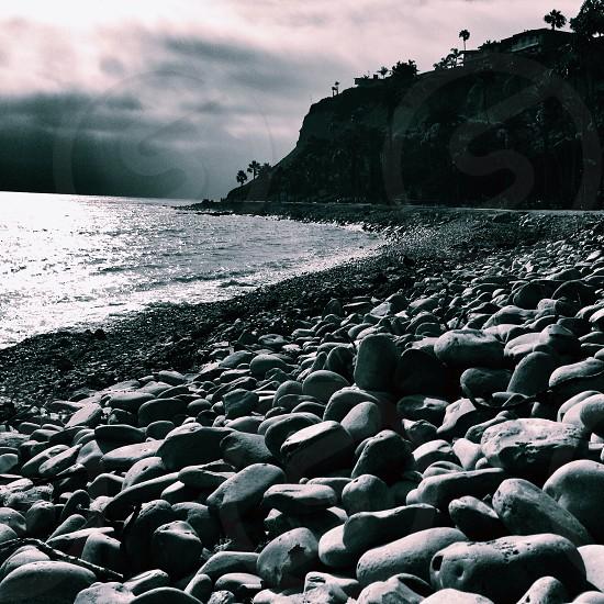 grey stones near water photo