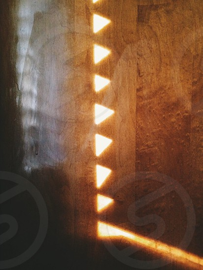 Light pattern from blinds on wood floor.  photo