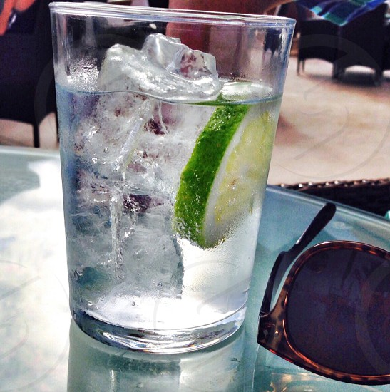 Green lime ice glass G&T drink gin and tonic lemon fruit sunglasses summer photo
