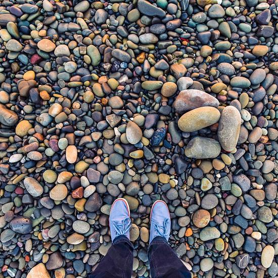 feet perspective rocks stones beach color photo
