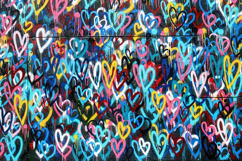 multicolored hearts graffiti wall during daytime photo