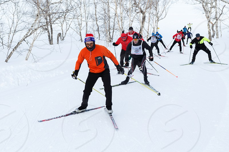 PETROPAVLOVSK CITY KAMCHATKA PENINSULA RUSSIAN FAR EAST - FEBRUARY 10 2018: Skiers running on ski track in winter forest. All-Russia mass ski race - Ski Track of Russia. photo