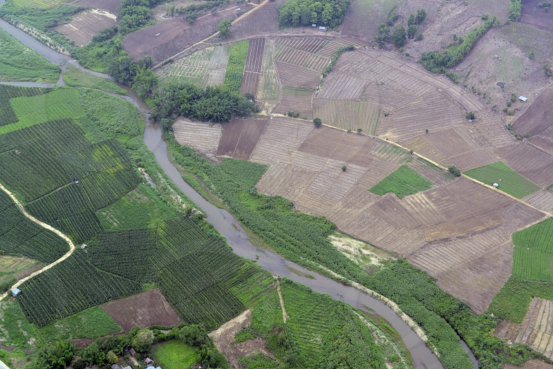 A river with fields on the way from Mae Hong Son to Pai in the north provinz of Mae Hong Son in the north of Thailand in Southeastasia. photo