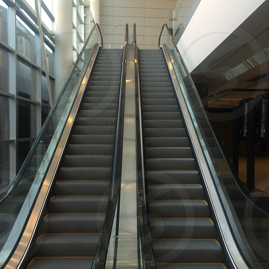 Stairs heaven escalator Calgary International airport silver polished railing travel  photo