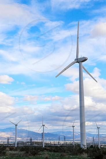 photo of wind turbine during daytime photo