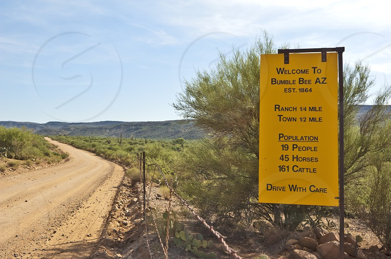A sign showing the population of the Arizona town of Bumble Bee. In this little town the horses and cattle outnumber the people. photo