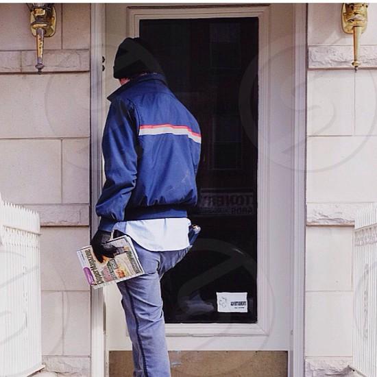man standing near the door photo