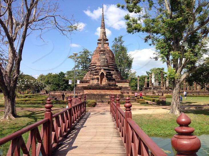temple near bridge and trees photo