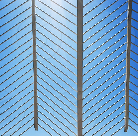 patterned white metal structure with diagonal lines photo