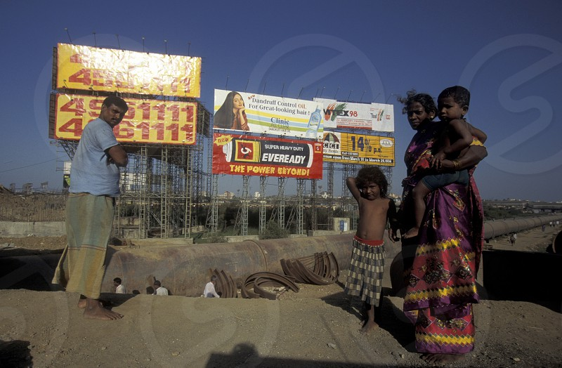 a Family in a slum and in front of promotions in the city of Bombay or Mumbai in India. photo