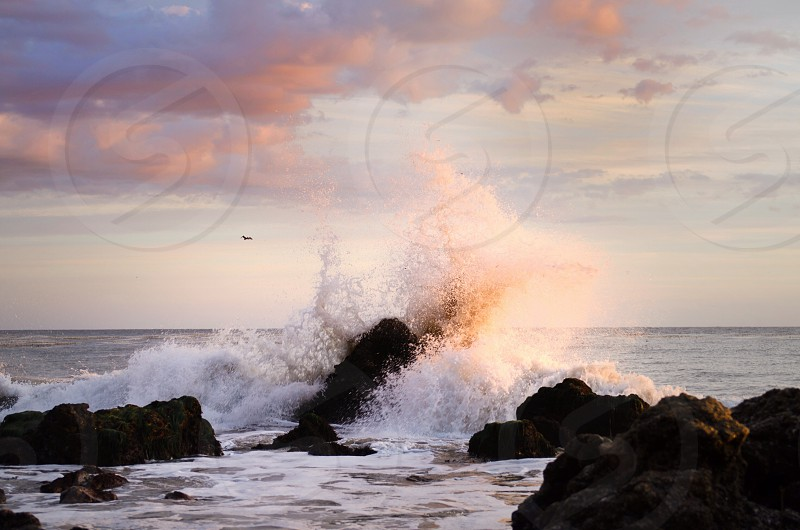 sea waves meeting rock photography photo