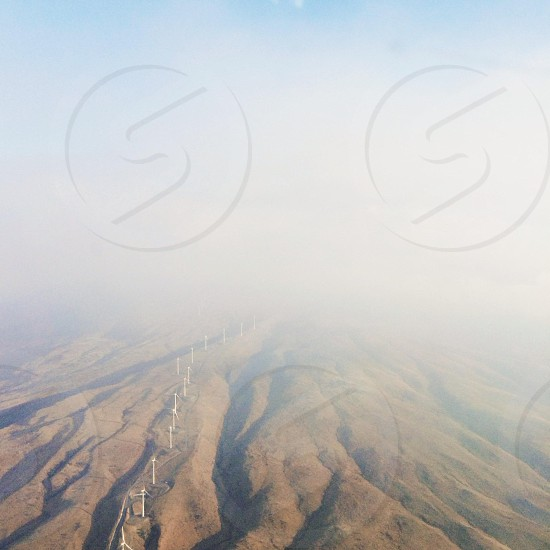 brown rolling hills under white fog photo