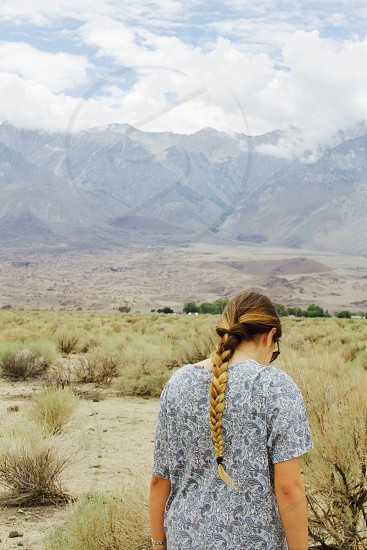 Braid girl hair long hair braids outdoors mountains magic mountain desert portrait no face looking down introspective inspire travel photo