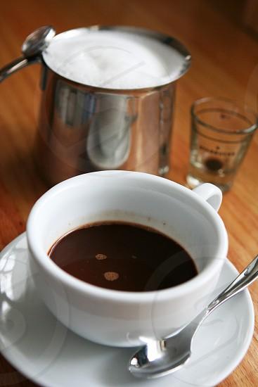 Makings of a yummy latte fresh espresso and foamy 2% milk photo