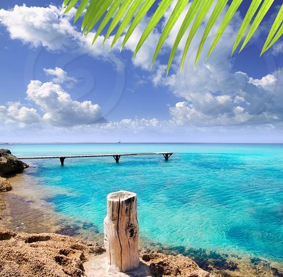 Illetes illetas beach with wooden pier and turquoise sea Formentera Balearic Mediterranean island photo