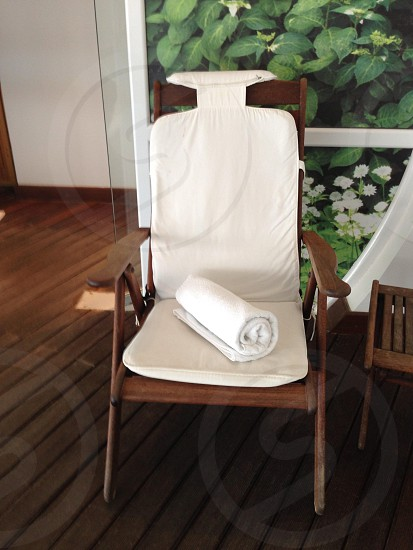 white rolled towel on chair photo