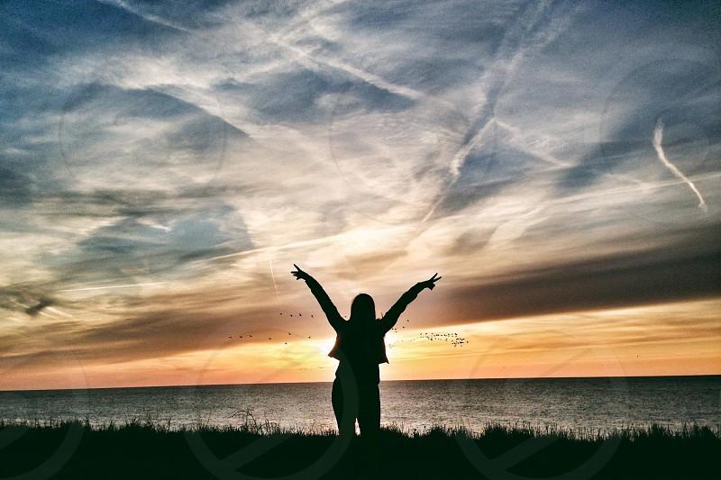 woman standing near sea photo