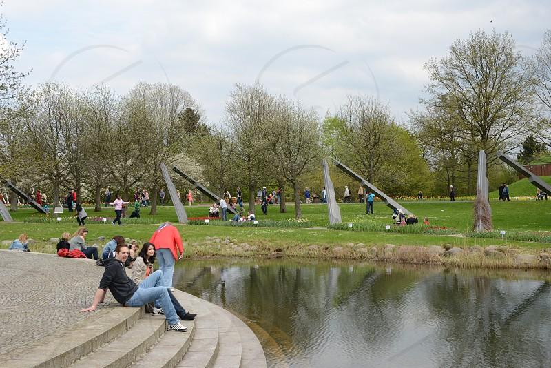 People visiting Britzer Garden in Berlin. Big Park in western part. photo