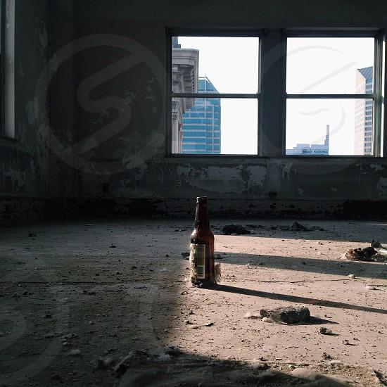 beer bottle on empty room photography photo