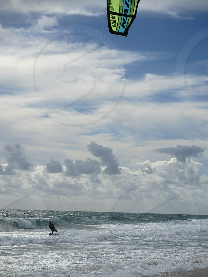 Kite surfing along the coast photo