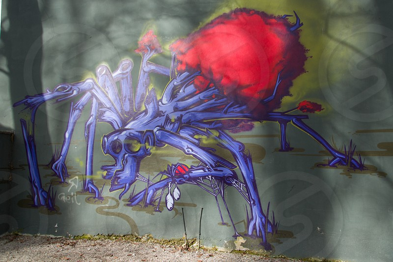 blue and red arachnid drawing photo