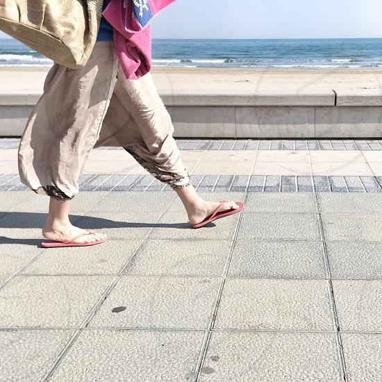 Women walking by the beach photo