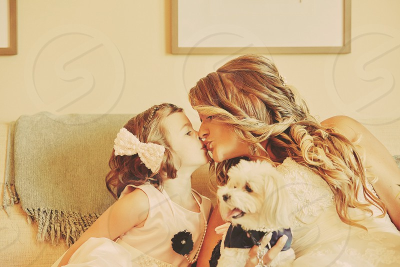 Bride wedding day flower girl flower dog dog wedding kisses family love sweet bridal suite best day kiss the day photo