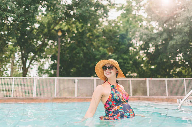A pregnant woman in the swimming pool.  photo