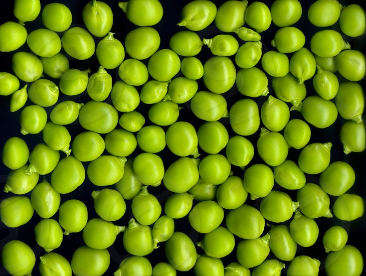 Texture and background of green peas on a black background photo