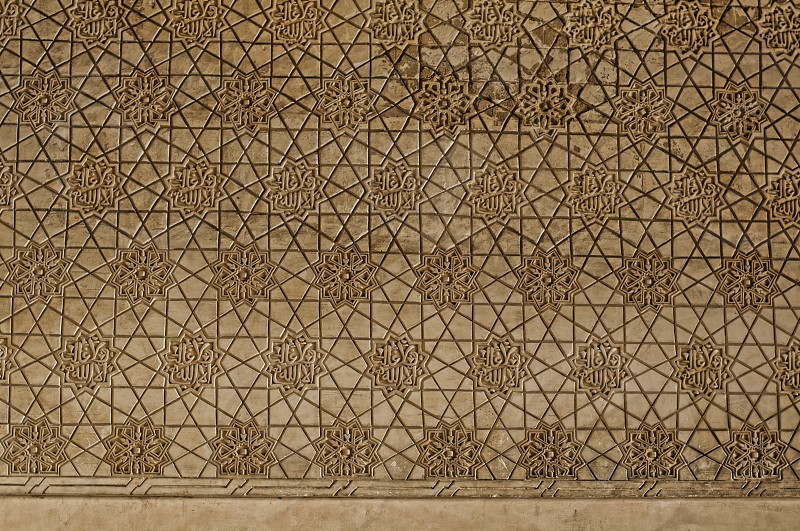 Islamic ornaments on a wall in an ancient castle photo