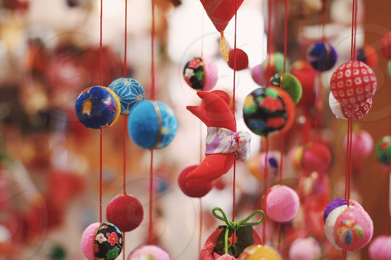 red string with round decors hanging on it photo