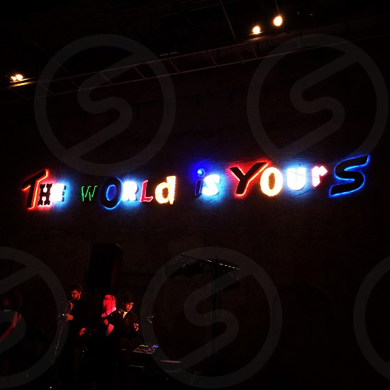 the world is yours neon lights signage photo